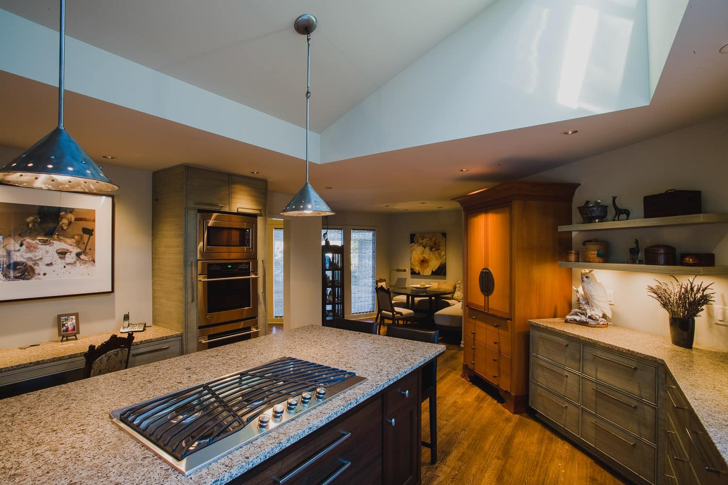 kitchen, cooktop, island, pendant light, granite counter, ovens, nook, custom refrigerator