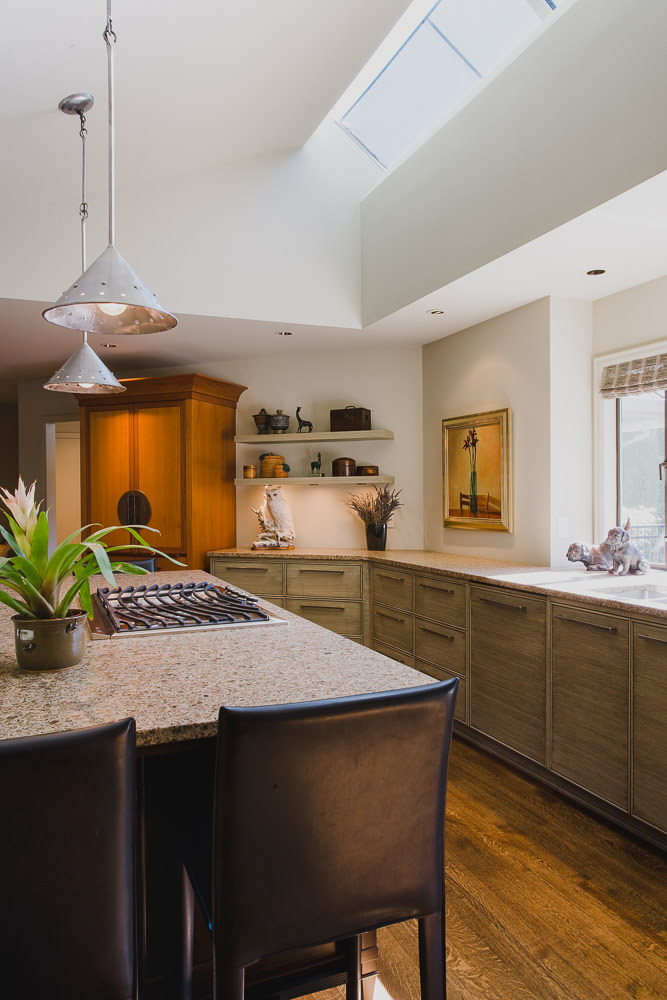 kitchen, hardwood floor, granite counter, island, cook top, pendant light, skylight