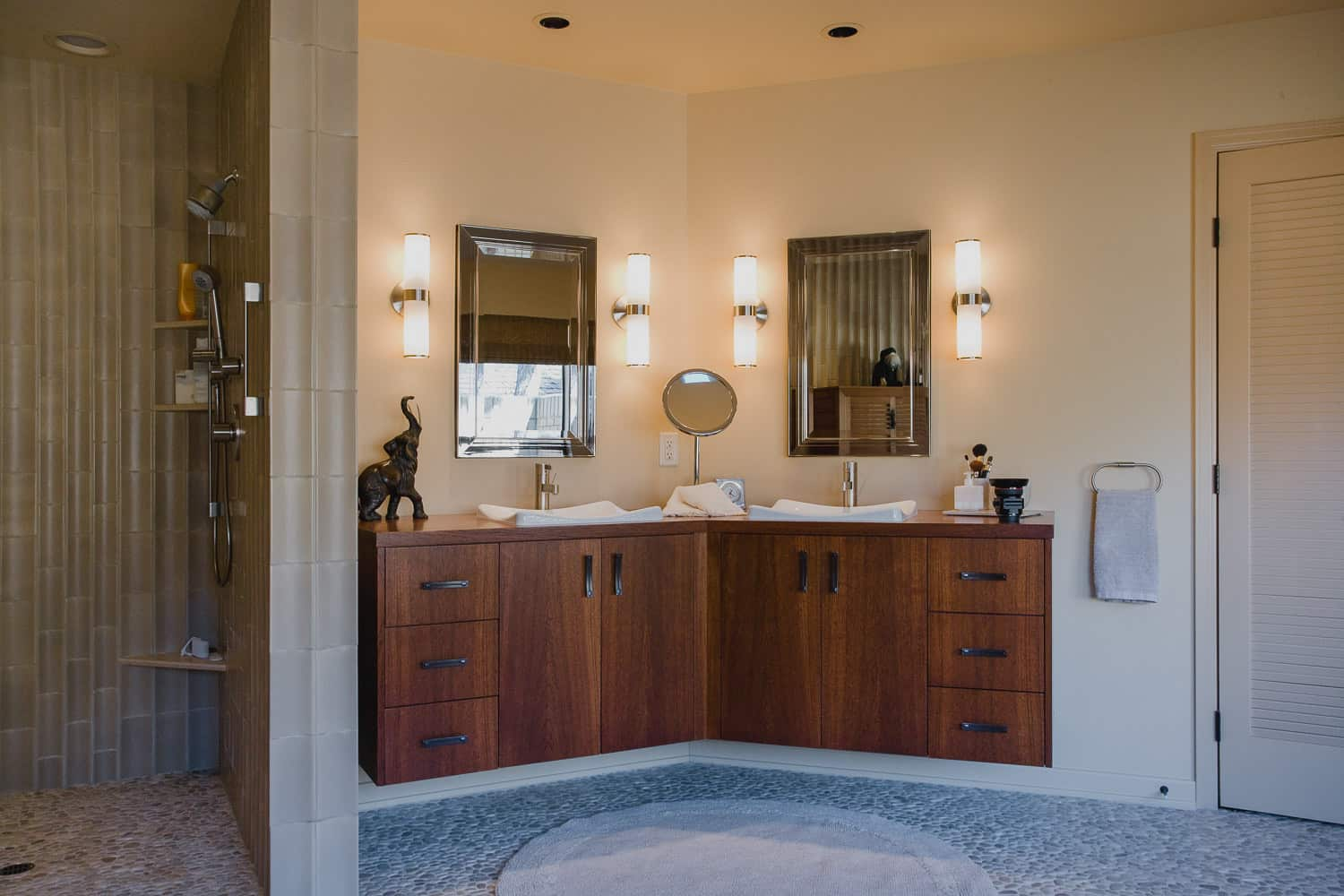 master bath, pebble tile, shower, floating cabinet, mirror